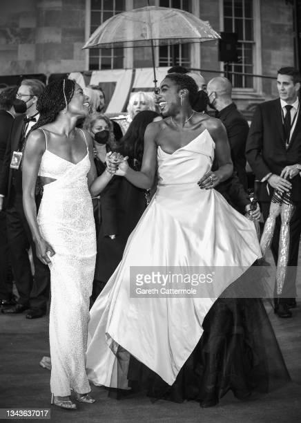 """Naomie Harris and Lashana Lynch attend the """"No Time To Die"""" World Premiere at Royal Albert Hall on September 28, 2021 in London, England."""
