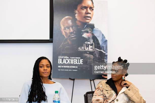 Naomie Harris and Nafessa Williams are seen during the Black Blue cast members' visit to Morehouse College on October 24 2019 in Atlanta Georgia