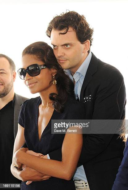 Naomie Harris and Peter Legler attend a lunch hosted by Len Blavatnik Harvey Weinstein and Warner Music during the 66th Cannes Film Festival on board...