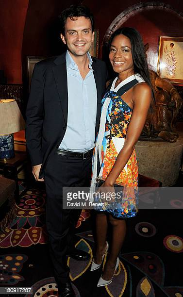 Naomie Harris and Peter Legler attend the Harper's Bazaar London Fashion Week SS14 closing party at Annabel's on September 17 2013 in London England