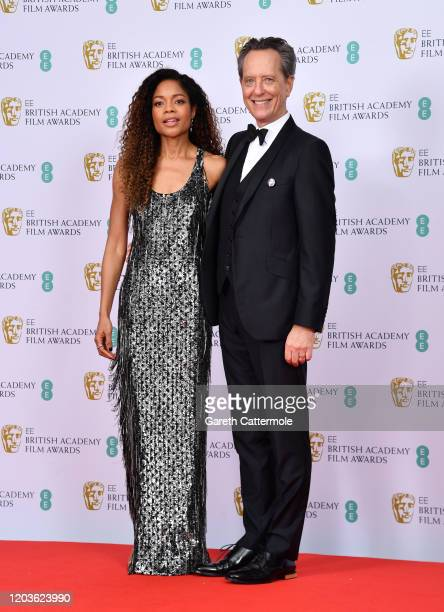 Naomie Harris and Richard E Grant in the Winners Room during the EE British Academy Film Awards 2020 at Royal Albert Hall on February 02 2020 in...