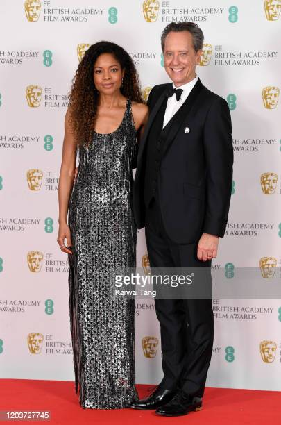 Naomie Harris and Richard E Grant pose in the Winners Room during the EE British Academy Film Awards 2020 at Royal Albert Hall on February 02 2020 in...