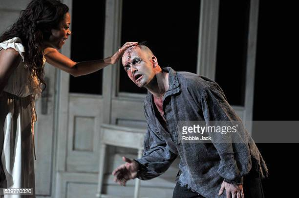 Naomie Harris as Elizabeth Lavenza and Jonny Lee Miller as The Creature in the National Theatre's production of Nick Dear's 'Frankenstein' directed...