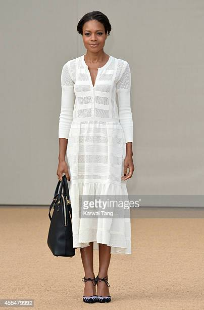 Naomie Harris attends the Burberry Prorsum show during London Fashion Week Spring Summer 2015 at Kensington Gardens on September 15 2014 in London...