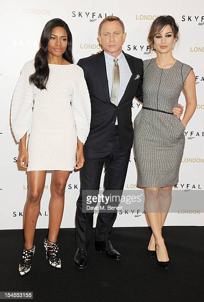 Naomie Harris Daniel Craig and Berenice Marlohe attend a photocall for the new James Bond film 'Skyfall' at The Dorchester on October 22 2012 in...