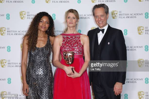 Naomie Harris Laura Dern and Richard E Grant pose in the Winners Room during the EE British Academy Film Awards 2020 at Royal Albert Hall on February...