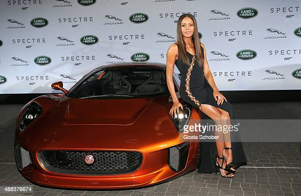 Naomie Harris next to a Jaguar CX75 during the presentation of the Jaguar Land Rover vehicles starring in the new Bond film 'Spectre' on September 15...