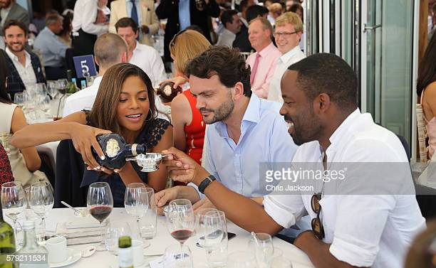 Naomie Harris Peter Legler and Chike Okonkwo attend the Royal Salute Coronation Cup at Guards Polo Club on July 23 2016 in Egham England