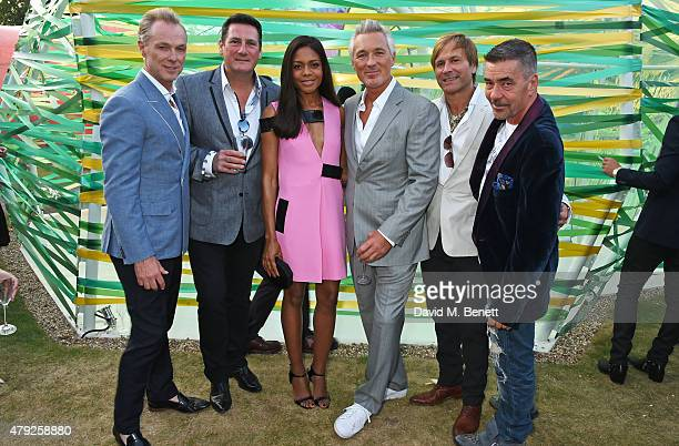 Naomie Harris poses with Gary Kemp Tony Hadley Martin Kemp Steve Norman and John Keeble of Spandau Ballet at The Serpentine Gallery summer party at...