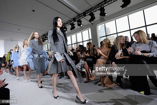 Naomie Harris Riley Keough Blake Lively and Elaine Lively watch as models walk the runway during the Michael Kors Fall 2016 Runway Show during New...