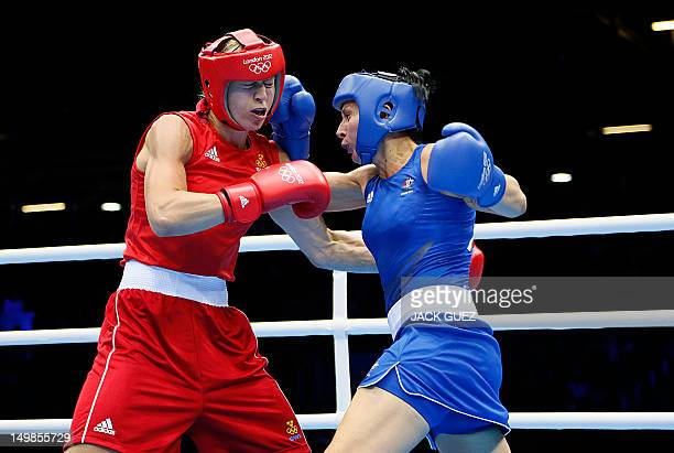 NaomiLee FischerRasmussen of Australia defends against Anna Laurell of Sweden during the women's Middleweight boxing round of 16 of the 2012 London...