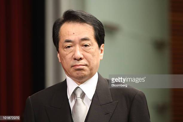 Naoto Kan Japan's newly appointed prime minister arrives for a news conference at the prime minister's official residence in Tokyo Japan on Tuesday...