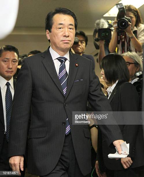 Naoto Kan Japan's newly appointed prime minister leaves a news conference at the headquarters of the Democratic Party of Japan in Tokyo Japan on...