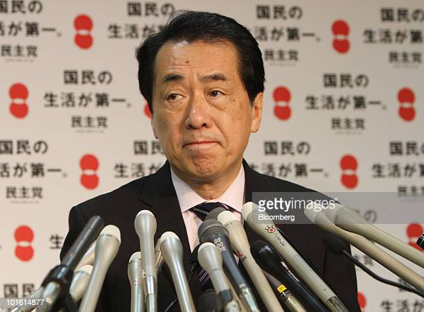 Naoto Kan Japan's newly appointed prime minister pauses during a news conference at the headquarters of the Democratic Party of Japan in Tokyo Japan...