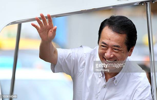 Naoto Kan Japan's prime minister and president of the Democratic Party of Japan waves as he arrives for a campaign rally for the July 11 Upper House...