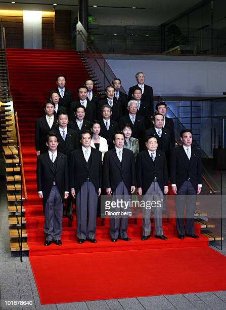 Naoto Kan Japan's prime minister center in the front row poses with his cabinet members including from left to right in the front row Tatsuo Kawabata...