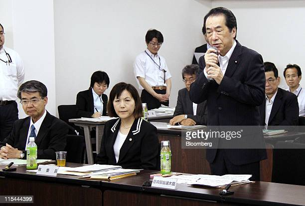Naoto Kan Japan's prime minister right speaks during the first meeting of the committee investigating the nuclear disaster at Tokyo Electric Power...