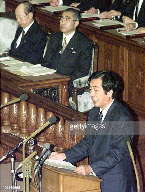 Naoto Kan leader of the main opposition Democratic Party of Japan responds to Prime Minister Keizo Obuchi's policy speech delivered 27 November...
