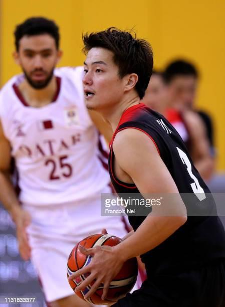 Naoto Tsuji of Japan controls the ball during the FIBA Basketball World Cup 2019 Asian Qualifier between Qatar and Japan at Al Gharrafa Sport Complex...