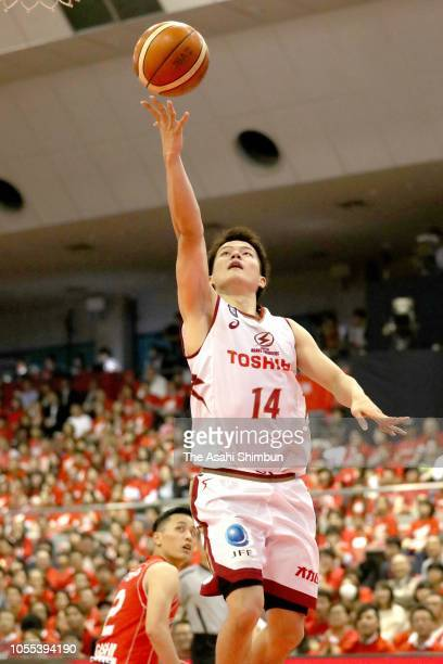 Naoto Tsuji of the Kawasaki Brave Thunders leaps for a lay up during the B.League B1 match between Chiba Jets and Kawasaki Brave Thunders at...