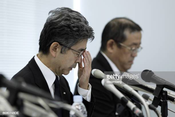 Naoto Umehara executive vice president of Kobe Steel Ltd left adjusts his glasses during a news conference in Tokyo Japan on Monday Oct 30 2017 Kobe...