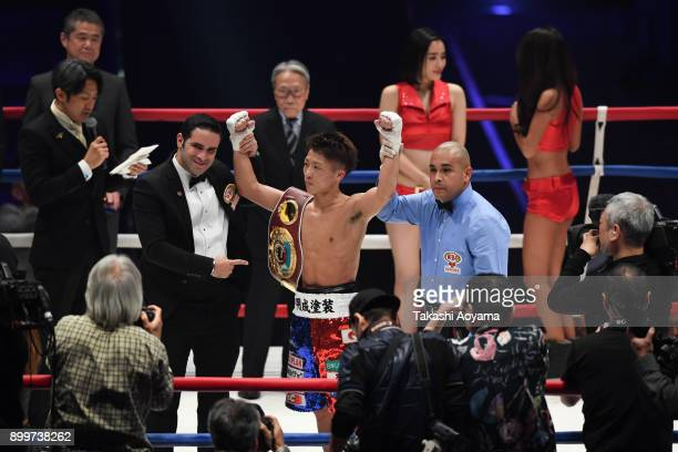 Naoya Inoue of Japan celebrates after defeating Yoan Boyeaux of France in their WBO Super Flyweight Title Bout at the Yokohama Cultural Gymnasium on...