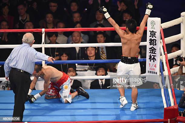 Naoya Inoue of Japan celebrates as Omar Andres Narvaez of Argentina downs in the firstround during the WBO World Super Flyweight Title bout between...