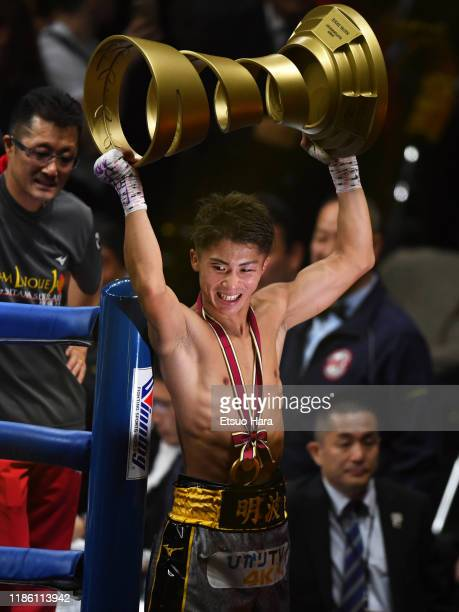 Naoya Inoue of Japan celebrates his victory by lifting the Muhammad Ali Trophy after the WBSS Bantamweight Final at Saitama Super Arena on November...