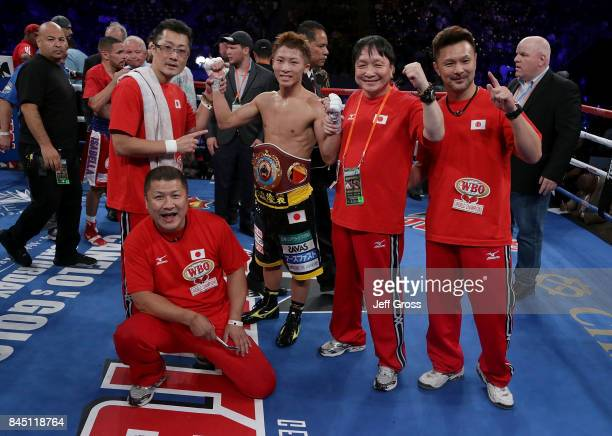 Naoya Inoue of Japan celebrates his victory over Antonio Nieves with his team at StubHub Center on September 9 2017 in Carson California