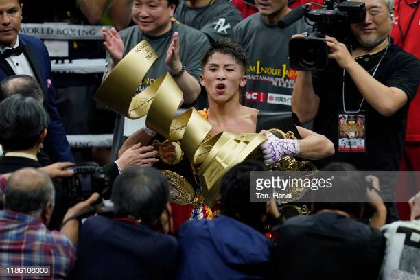 Naoya Inoue of Japan celebrates with the trophy after defeating Nonito Donaire of the Philippines at the WBSS Bantamweight Final at Saitama Super...