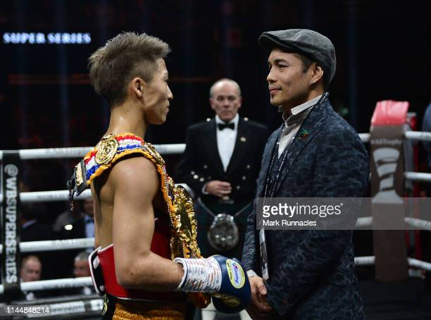 Naoya Inoue of Japan is congratulated by his opponent for the final of the series Nonito Gonzales Donaire of Philippines after beating Emmanuel...