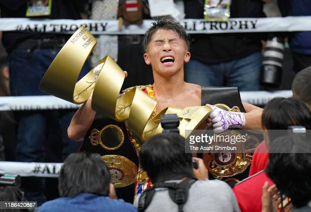 Naoya Inoue of Japan lifts the trophy after beating Nonito Donaire of the Philippines after the WBSS Bantamweight Final at Saitama Super Arena on...