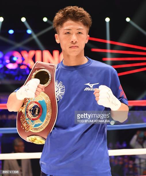Naoya Inoue of Japan poses for photographers after his victory over opponent Yoan Boyeaux of France in their WBO junior bantamweight boxing title...
