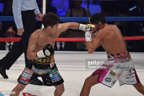 Naoya Inoue of Japan punches champion Jamie McDonnell of Great Britain during their WBA Bantamweight Title Bout at OtaCity General Gymnasium on May...