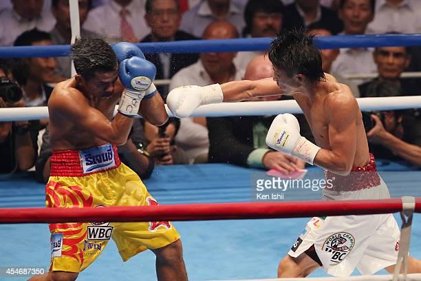 Naoya Inoue of Japan punches Samartlek Kokietgym of Thailand during the WBC light flyweight title bout between Naoya Inoue of Japan and Samartlek...