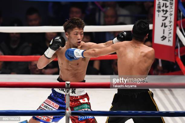 Naoya Inoue of Japan punches Yoan Boyeaux of France during their WBO Super Flyweight Title Bout at the Yokohama Cultural Gymnasium on December 30...