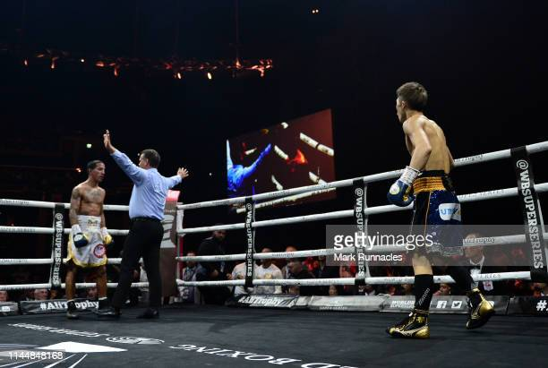 Naoya Inoue of Japan watches on as Emmanuel Rodriguez of Puerto Rico tries to beat the count during the WBSS Bantamweight Semi Final IBF World...