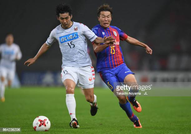 Naoya Kikuchi of Consadole Sapporo and Kensuke Nagai of FC Tokyo compete for the ball during the JLeague J1 match between FC Tokyo and Consadole...