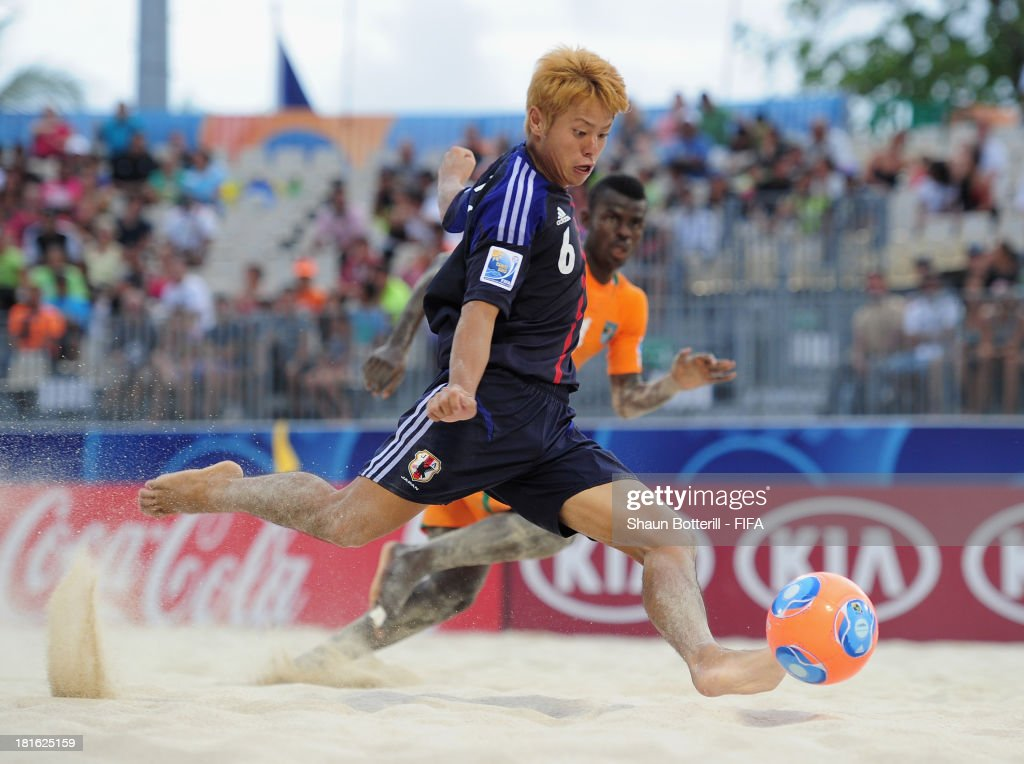 Naoya Matsuo of Japan fires in a shot during the FIFA Beach Soccer World Cup Tahiti 2013 Group D match between Japan and Ivory Coast at the Tahua To'ata stadium on September 22, 2013 in Papeete, French Polynesia.
