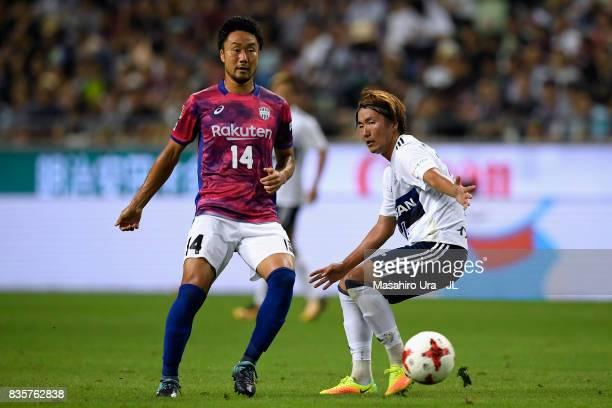 Naoyuki Fujita of Vissel Kobe and Jun Amano of Yokohama F.Marinos compete for the ball during the J.League match between Vissel Kobe and Yokohama...