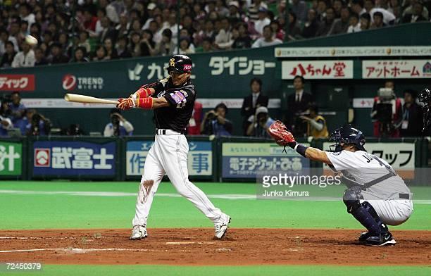 Naoyuki Omura of Fukuoka Softbank Hawks hits the ball while catcher Kenji Johjima of the Seattle Mariners holds his mitt during the Aeon All Star...