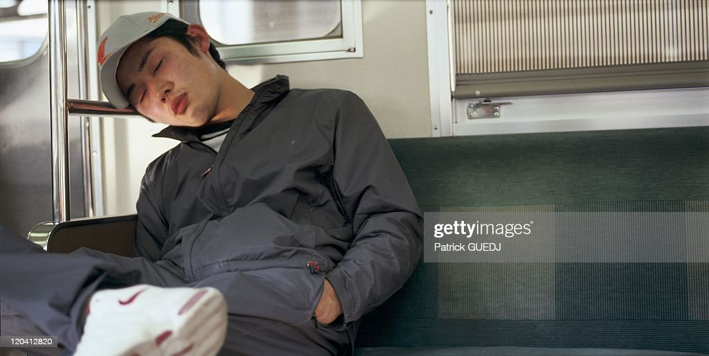 Nap In The Metro In Tokyo, Japan - : News Photo
