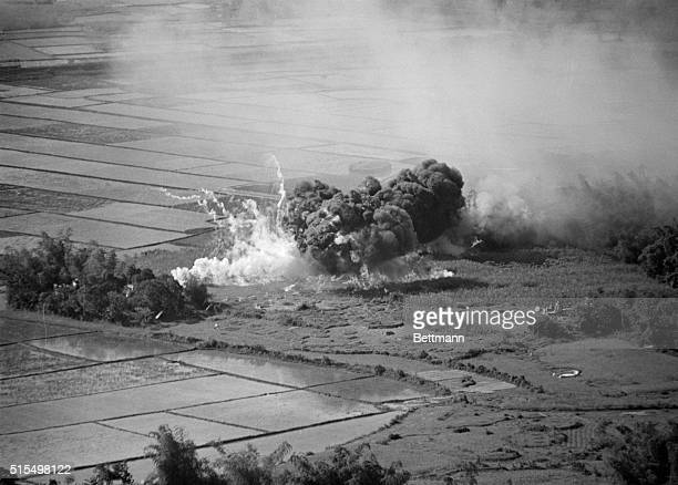 A napalm bomb dropped on suspected Communist target sends up billows of smoke after being released from a US Air Force plane south of Da Nanag...