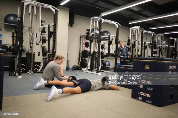 Napheesa Collier and Katie Lou Samuelson during warm down and stretching under the supervision of strength coach Amanda Kimball during the UConn...