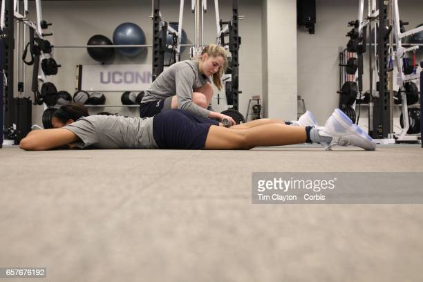 Napheesa Collier and Katie Lou Samuelson during warming down and stretching under the supervision of strength coach Amanda Kimball during the The...