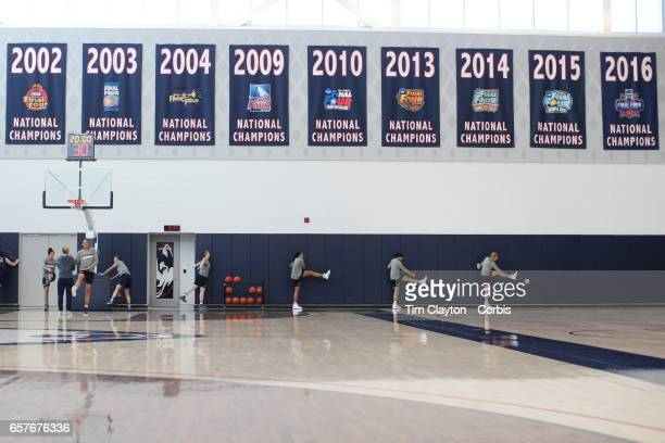 Napheesa Collier Gabby Williams and Katie Lou Samuelson with team mates warming up under the National Champions banners while under the supervision...