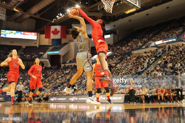 Napheesa Collier of the Connecticut Huskies has her shot blocked by Kaila Charles of the Maryland Terrapins during the the UConn Huskies Vs Maryland...
