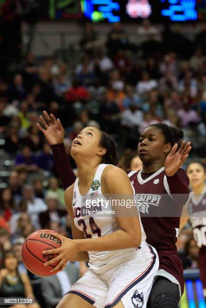 Napheesa Collier of the Connecticut Huskies looks to shoot against Breanna Richardson of the Mississippi State Lady Bulldogs in the third quarter...