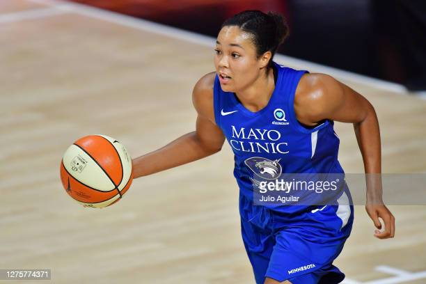 Napheesa Collier of the Minnesota Lynx dribbles during the second half of Game One of their Third Round playoff against the Seattle Storm at Feld...