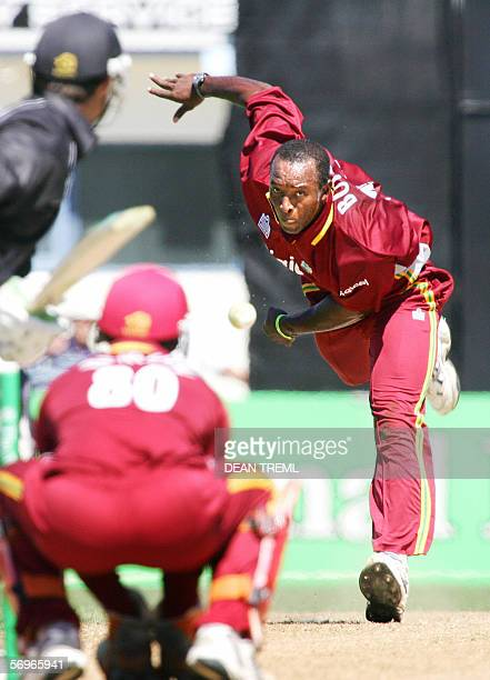 Deighton Butler of the West Indies bowls to Nathan Astle of the New Zealand Black Caps during the 4th ODI of the five match series between New...